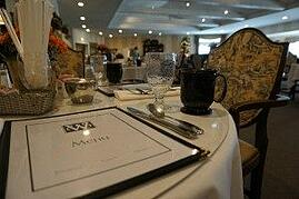 The Weatherly Inn's dining room feels like a restaurant, complete with centerpieces and menus. Photo credit: Kristin Kendle.
