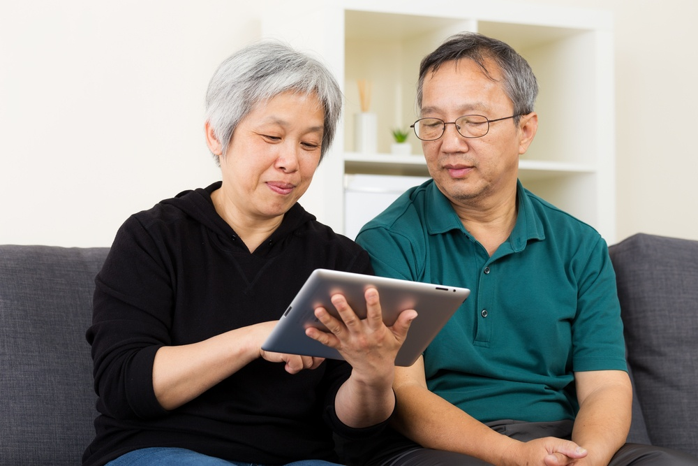 Asian old couple using tablet