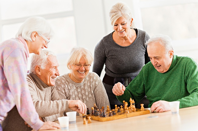 Friends playing chess at Weatherly Inn Independent Living Community