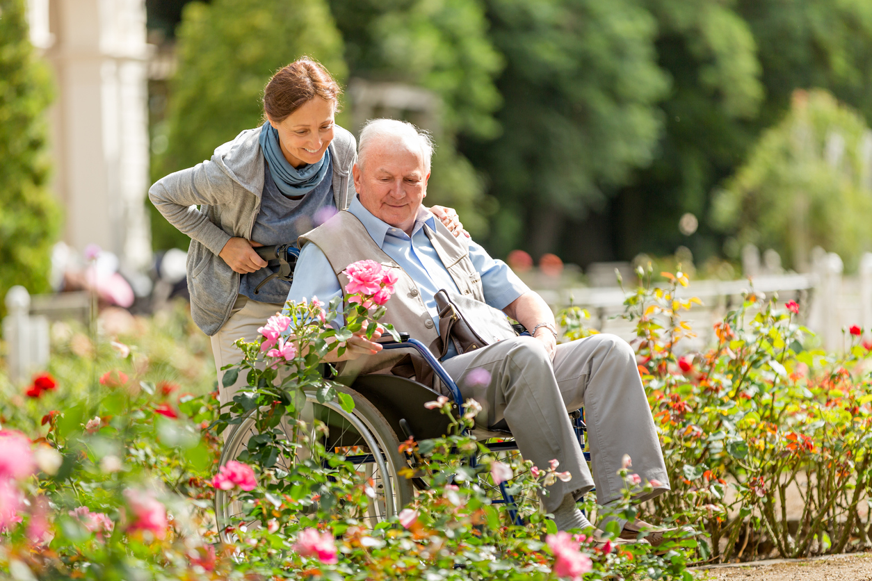 elderly man and woman enjoying assisted living