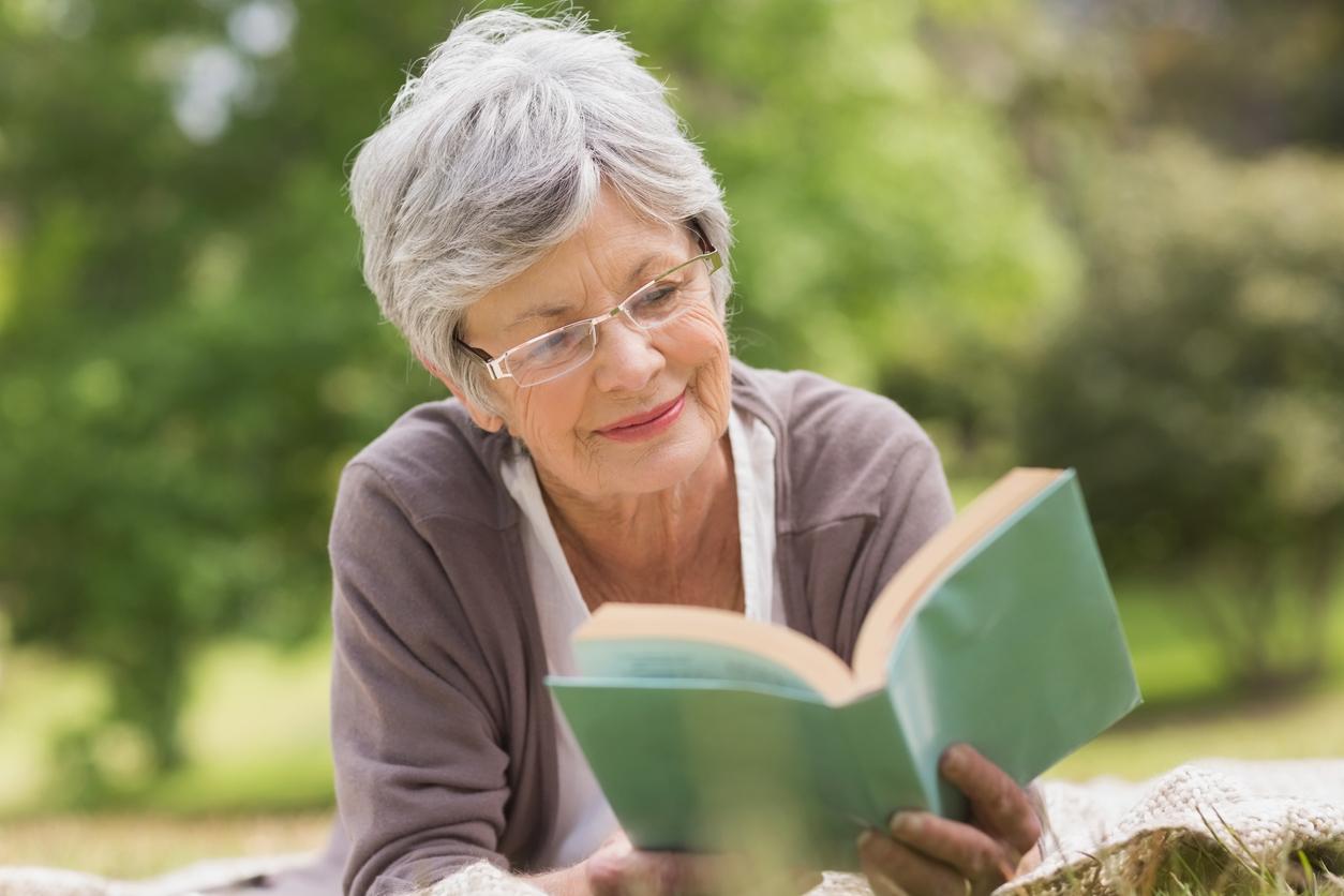 Senior reading outdoors