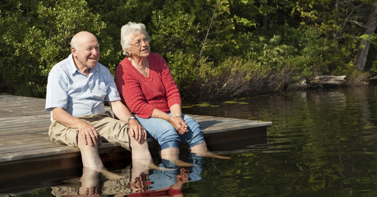 Senior living | Senior couple enjoying a day out by the lake